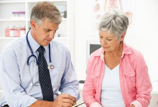 Bigstock-Doctor-with-female-patient-21258332 copy